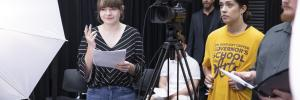 students with camera in acting class
