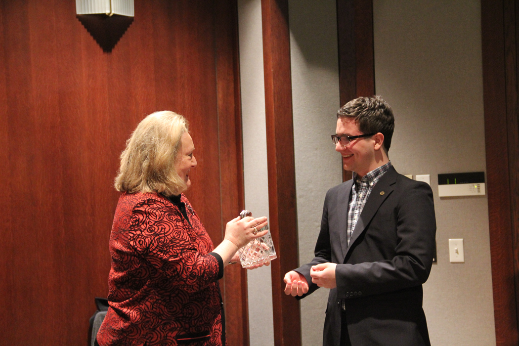 Linda Breathitt, daughter of the late Governor Breathitt, presents the award to the 2014 Breathitt Lecturer, Evan Sweet.
