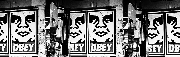 "andre the giant ""obey"" graffiti posters on concrete walls"