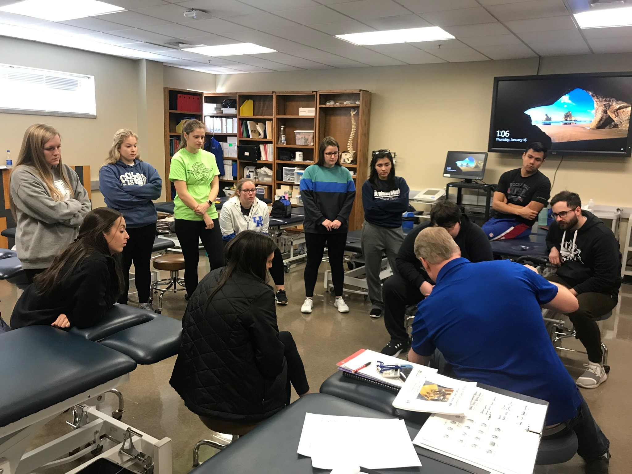 Students watch as Dr. Pat Kitzman teaches how to refurbish medical equipment.