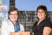 Dean Nancy Cox presenting award to Shari Dutton