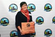 Shari Dutton receives a Lexington-Fayette Urban County Environmental Commission award.