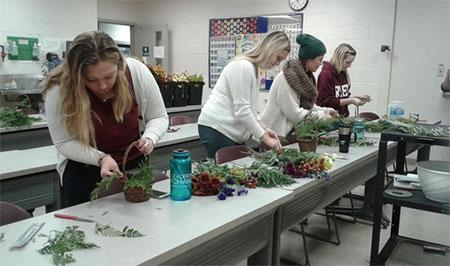 UK Hort Club members assemble fall baskets.