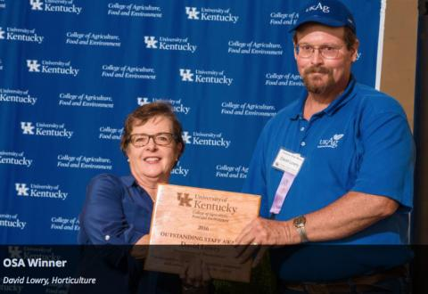 Dean Nancy Cox presenting an Outstanding Staff Award to Dave Lowry