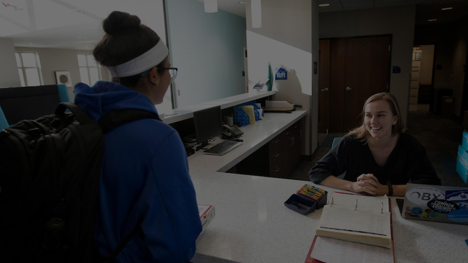 Photo of female student checking in to her residence hall