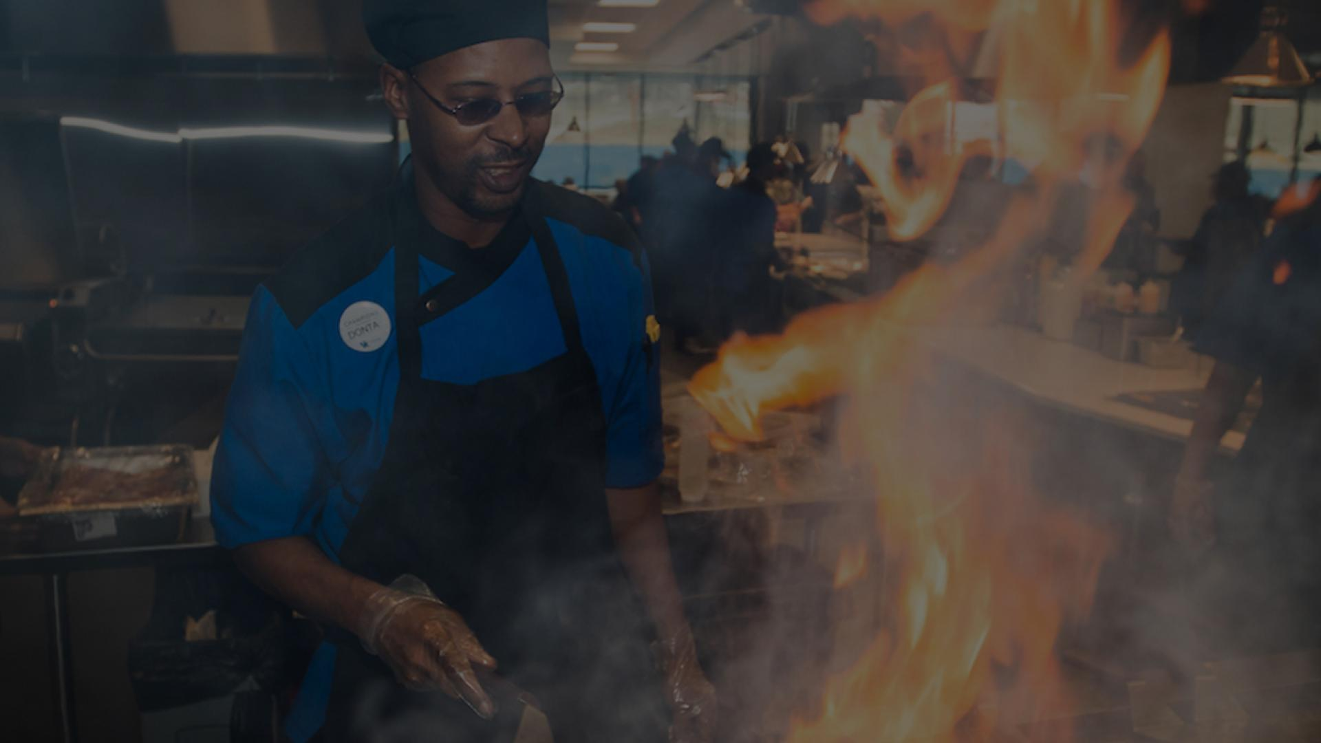 A chef cooks up a blazing meal in the new Student Center cafeteria