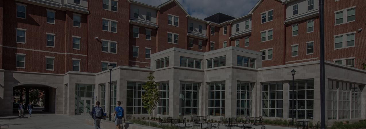 Exterior of New Lewis Honors College Residence Hall With Students Walking Toward the Entrance