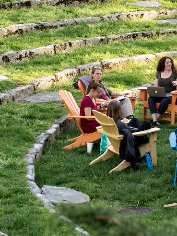 Students Enjoying a Relaxed Discussion at the Memorial Hall Amphitheatre