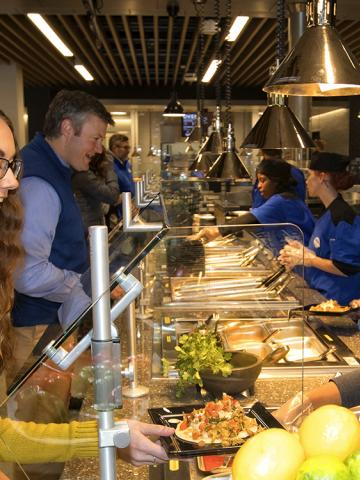 Female Student Being Served by Staff in the New Student Center's Champions Kitchen