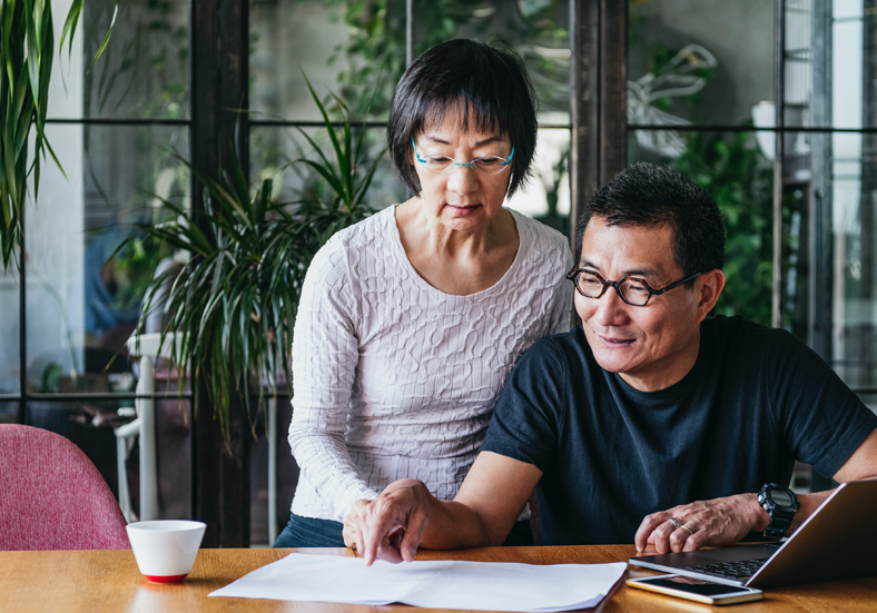 Couple working on planning retirement finances together