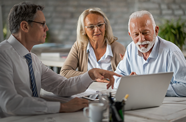 Financial advisor reviewing finances with a couple