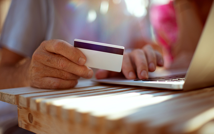 Person holding flexible spending account card.