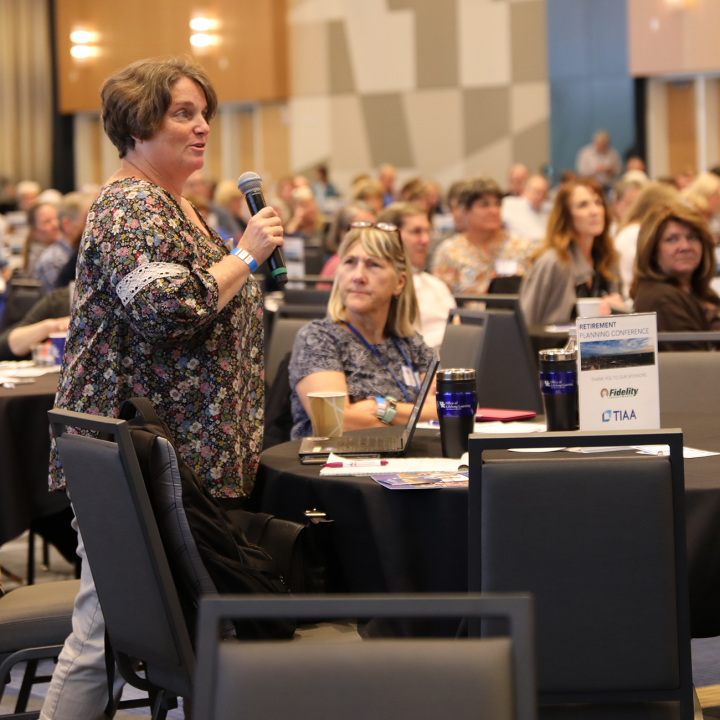 Attendee asks a question at the retirement planning conference in 2019