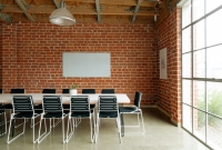 empty room with brick wall and modern chairs