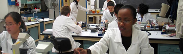 science laboratory with students in white coats