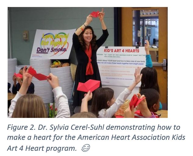 Figure 2. Dr. Sylvia Cerel-Suhl demonstrating how to make a heart for the American Heart Association Kids Art 4 Heart program.
