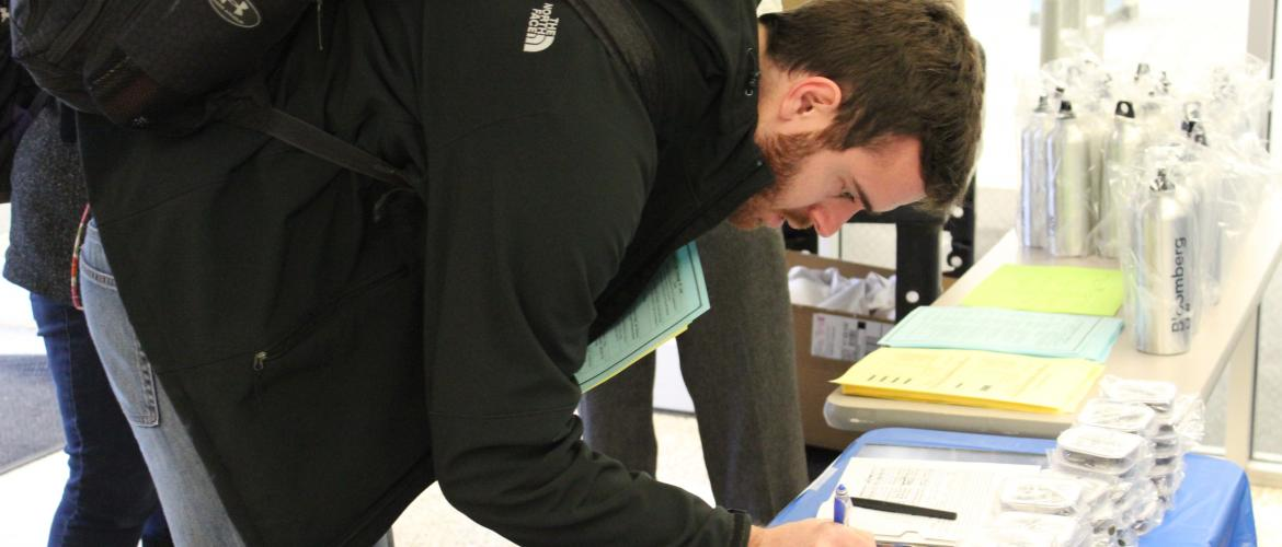 Picture of participant registering for the Dean's Challenge