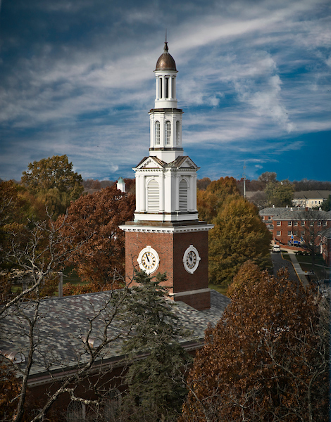 Photo of UK's Memorial Hall steeple during a sunny fall day