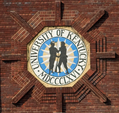 Photo of the Seal of the University of Kentucky on a brick building