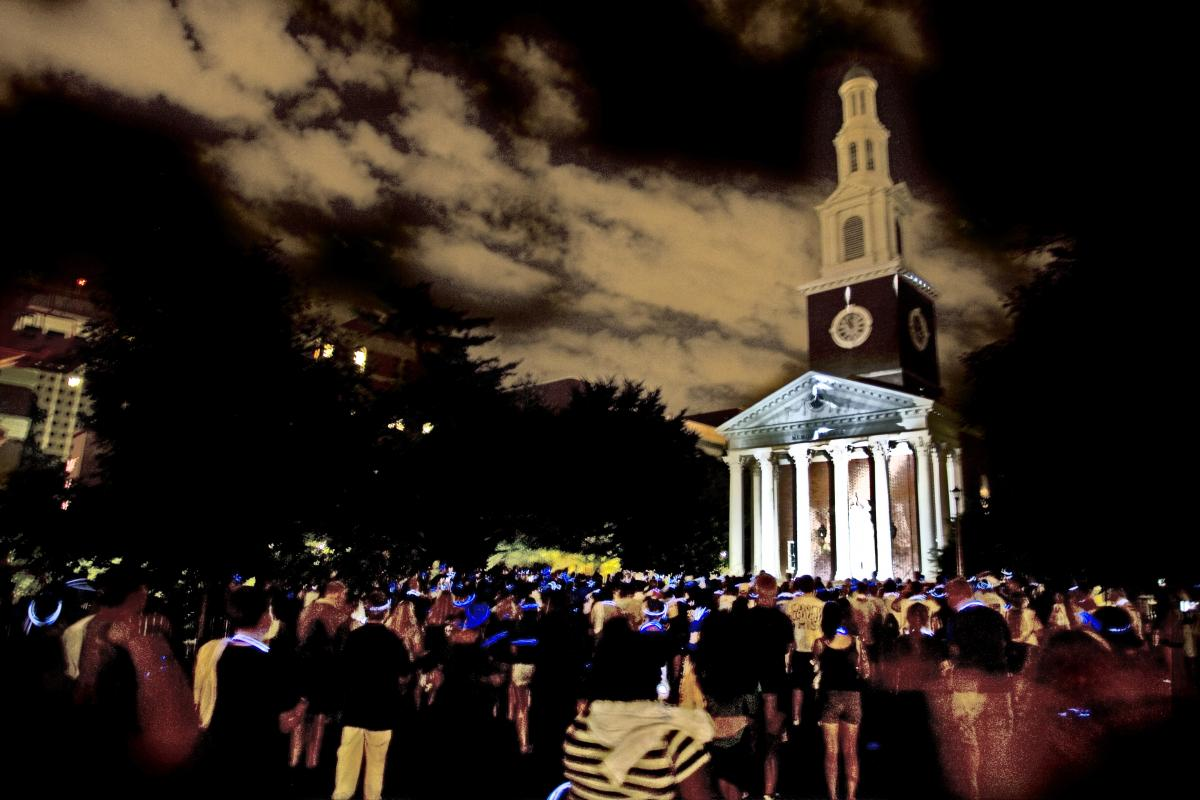 Photo of nighttime vigil in front of UK's Memorial Hall