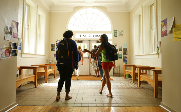 Photo of students talking as they walk the interior of UK's Miller Hall foyer
