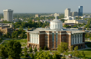 Photo of UK's William T. Young Library with downtown Lexington in the background